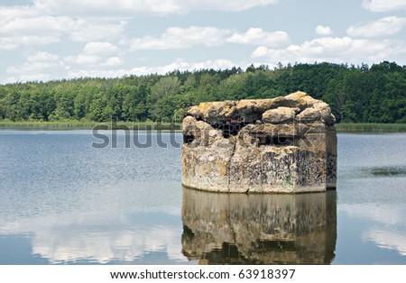 old sunken bunker since the 2-nd World War - stock photo