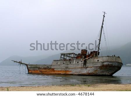 Old sunken ship - stock photo