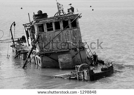 Old Sunken Tugboat - stock photo
