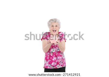 Old surprised woman holding a piggy bank against a white background - stock photo