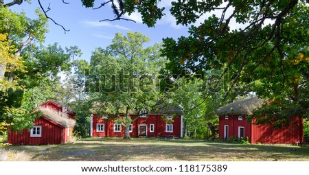 Old Swedish houses with oak tree frame - stock photo