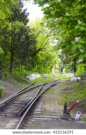Old switches at the railway station. In the old station wagons are waiting on cassation. - stock photo