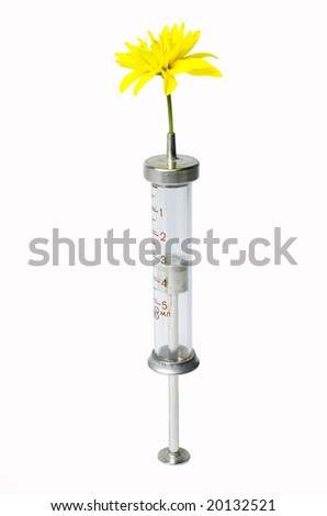 old syringe with yellow flower - stock photo