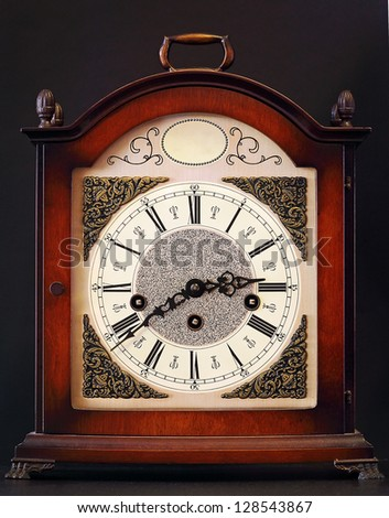 Old table clock with decorations, vintage style
