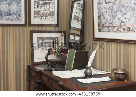 Old table, microscope, writing utensils on a table in a corner of the museum of tractors. City Cheboksary, Chuvash Republic, Russia. 06/05/2016