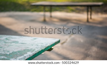 Old table tennis ping pong table close up in sunny steet park