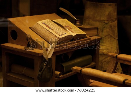 Old table with the ancient book. Vintage