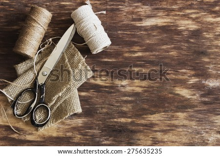 old tailoring scissors and supplies for sewing on an old wooden background. top view. copy space background - stock photo