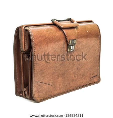 Old tan leather briefcase isolated on a white background. - stock photo
