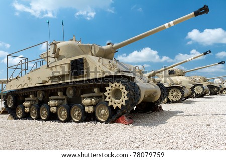 Old tanks against the blue sky. Museum of tanks. Israel. Latrun. - stock photo