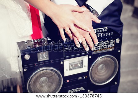 old tape-recorder holding in their hands - stock photo