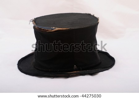 Old tattered top hat on a white background - stock photo