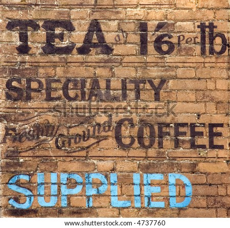 Old tea and coffee advert painted on a brick wall.