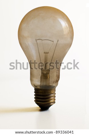 Old technology and wasting electricity, burned out light bulb - no idea concept - stock photo