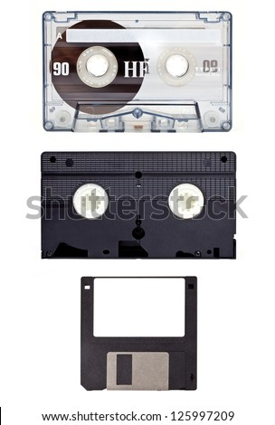 Old technology devices - Audio Cassette Tape, Video Tape and a Floppy Disc. - stock photo