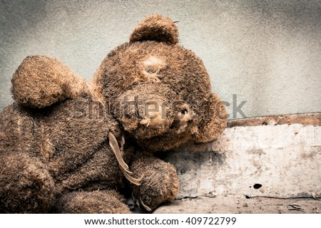 Old teddy bear abandoned piles of paper,black and white tone - stock photo