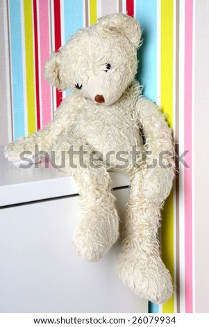 old teddy-bear on striped background - stock photo