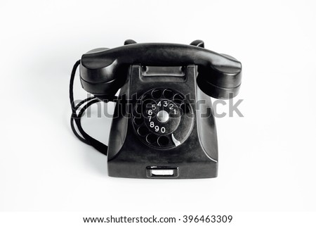old telephone a black vintage rotary phone on a white background