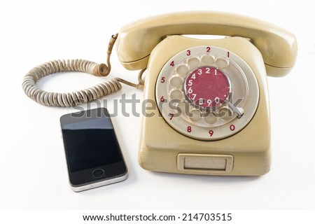 old telephone and smart phone on white background  - stock photo