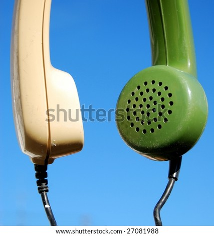 Old telephone handles against a blue sky - stock photo