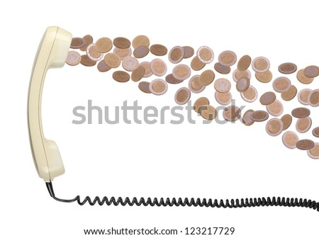 old telephone headset with coins - stock photo
