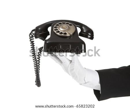 Old Telephone in battler hand - stock photo