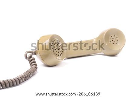 Old telephone on isolated white background - stock photo