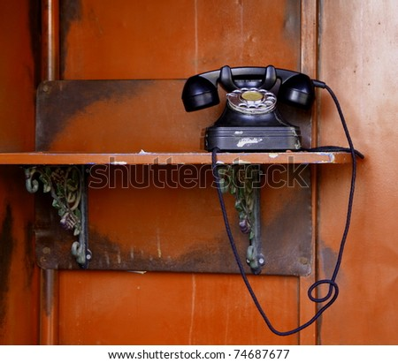Old telephone on red wall ,798, china