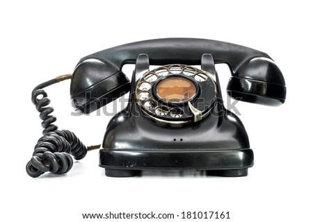 Old telephone on white background. - stock photo