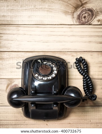 Old telephone on wood background., Flat lay with copy space. - stock photo