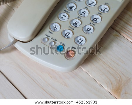 Old telephone on wooden table, selective focus. - stock photo