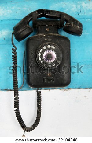 Old telephone over blue background. Retro object - stock photo