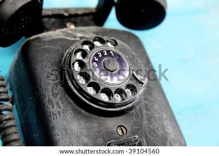 Old telephone over blue background. Retro object - stock photo