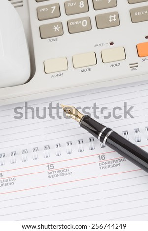 Old Telephone with notebook and fountain pen - stock photo