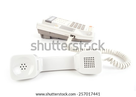 Old Telephone with pick up receiver over white - stock photo