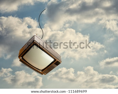 Old Television Falling Down From Sky, Outdoors - stock photo