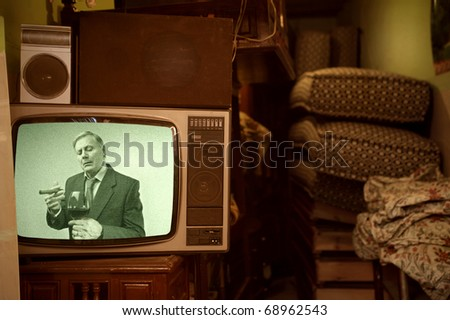 Old television showing a senior gentleman - stock photo