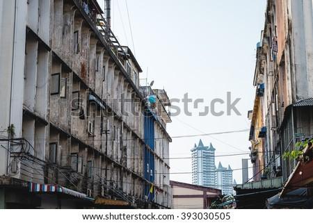 Old tenement buildings in bangkok - stock photo