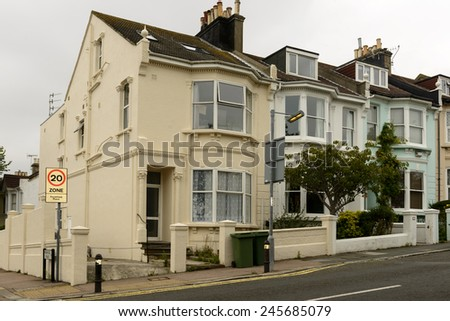 old terrace at Brighton, view of a row of old houses on an uphill street in touristic sea town,  Brighton, East Sussex  - stock photo