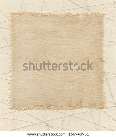 Old textile tag on the sacking - stock photo