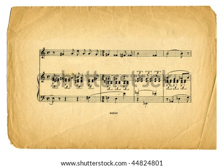 old textured music sheet  page on white background - stock photo