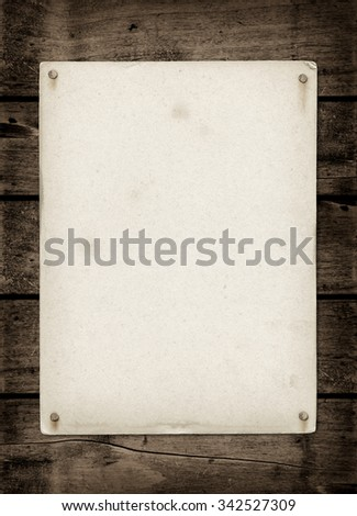 Old textured paper sheet on a dark wood table. horizontal Mockup - stock photo
