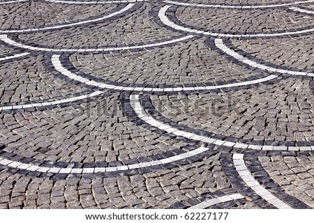 Old Textured Paved Road - stock photo