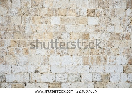 Old textured stone wall background in textured white Istrian marble on the Stradun in Dubrovnik Croatia - stock photo