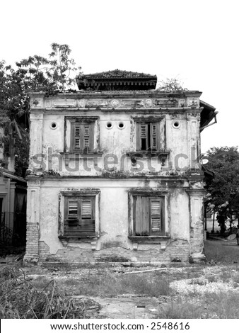 Old 19th century building, falling apart. Black and white photo.