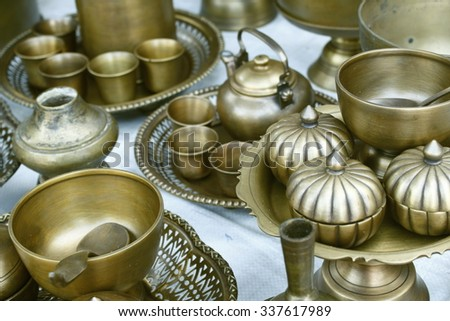 old thai brass utensil for sale in a native ancient market. used-brass utensil for sale in a native ancient market.