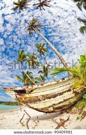 Old Thai fishing boat at the beach. Koh Koodi island. Thailand - stock photo