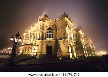 Old theater in night scenery. Cracow Poland. - stock photo