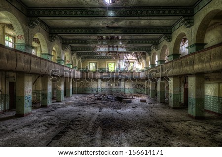 old theater inside decayed russian barracks in former eastern germany - stock photo