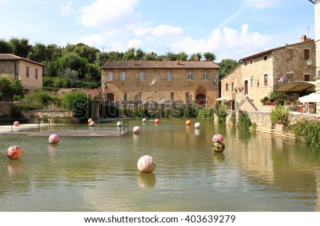 Old thermal baths in the medieval village of Bagno Vignoni. Tuscany, Italy - stock photo